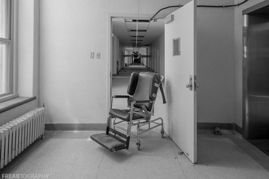 restraint chair found in the hallways of an abandoned psychiatric