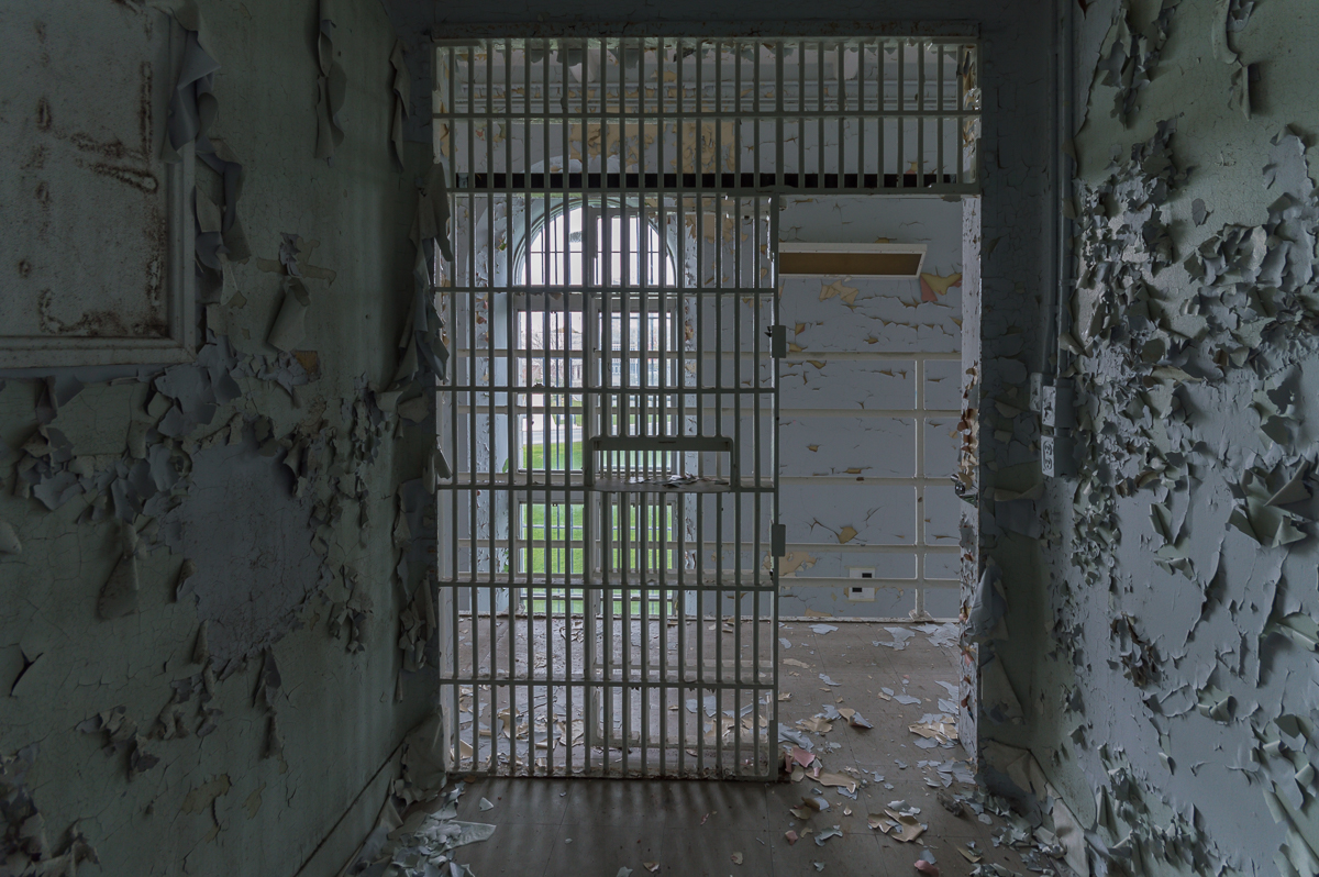 the view from inside a jail cell in an abandoned canadian